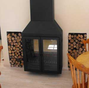 Double-sided fireplace - freestanding on one side, built-in on the other side.